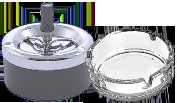 Aparece un cenicero con tapa y pulsador y el tradicional cenicero de cristal